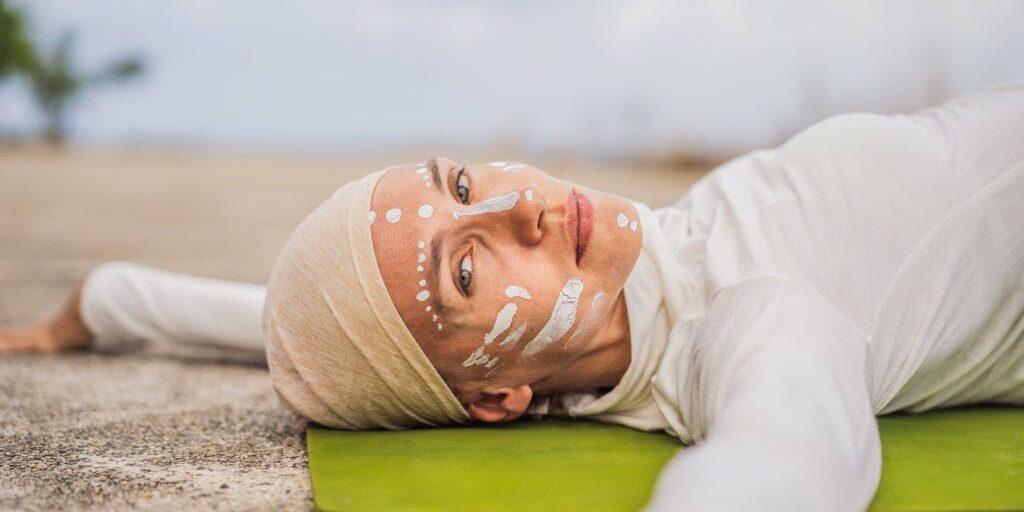 Kundalini Yogi wearing white with head covered